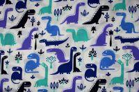 Bílá bavlna s modrými dinosaury