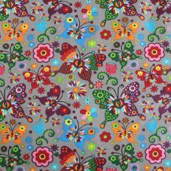 Šedá bavlna s barevnými motýlky
